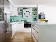 Seagrass Corian® worktops give this kitchen the wow factor