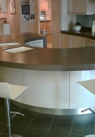 Canyon Corian® Curved Horseshoe Island