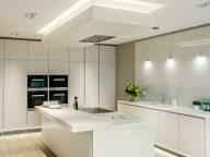 Glacier White Corian Kitchen With Solid Wood Breakfast Bar