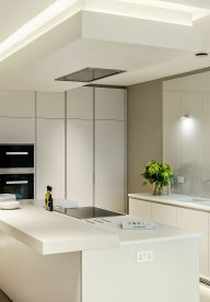 Glacier White Corian Kitchen With Solid Wood Breakfast Bar