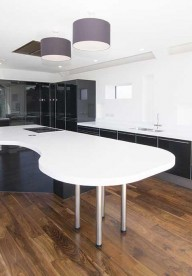 Corian® curved island with large breakfast bar