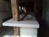 Corian® Wrapping Around Old Beams